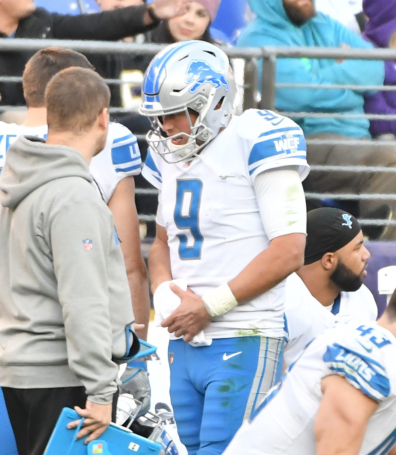 Lions quarterback Matthew Stafford along the sidelines