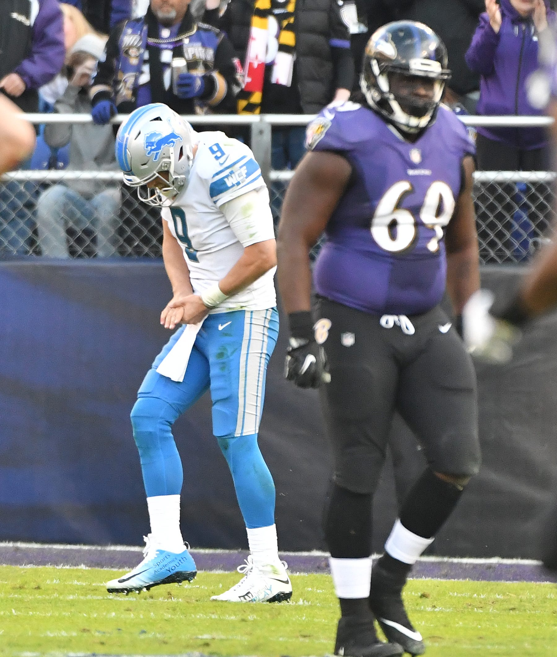 Lions quarterback Matthew Stafford heading to the sidelines