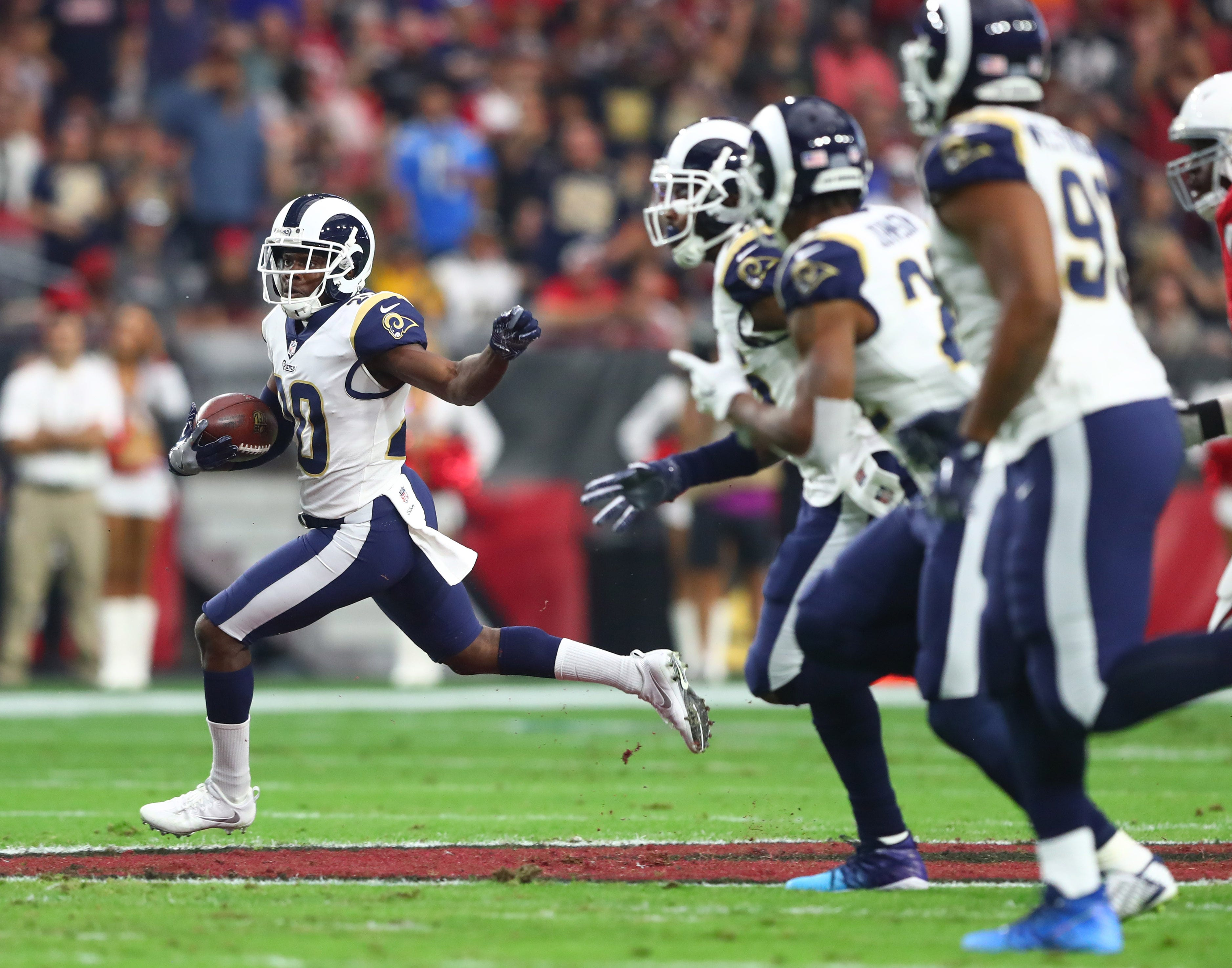 Los Angeles Rams safety Lamarcus Joyner returns a first