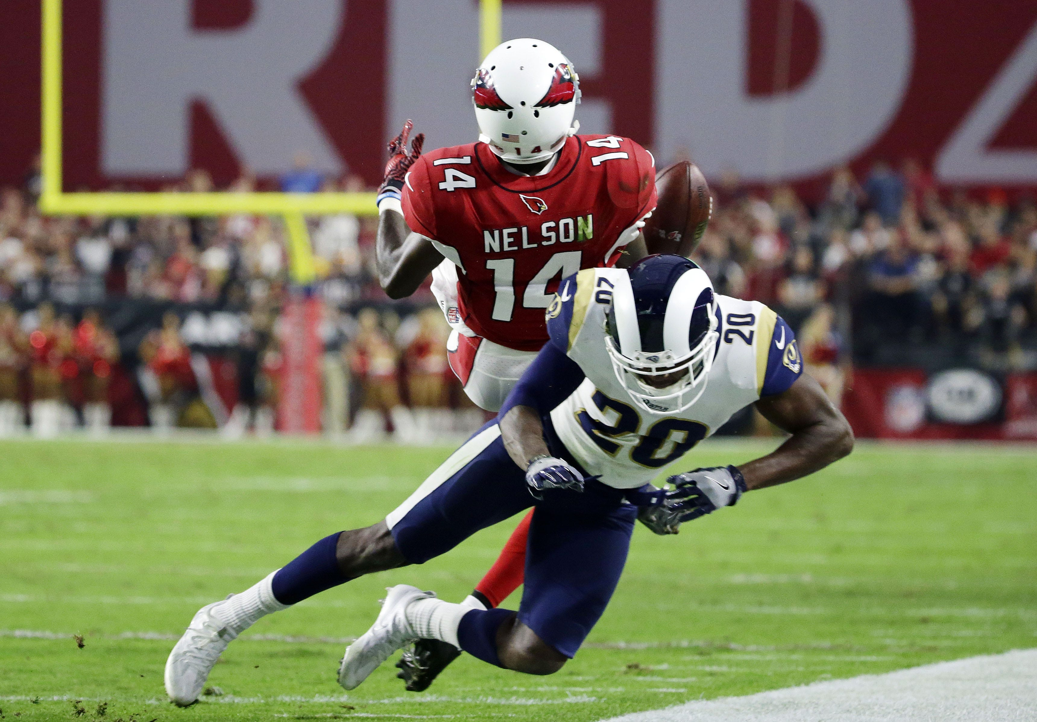 Arizona Cardinals J.J. Nelson loses the ball after
