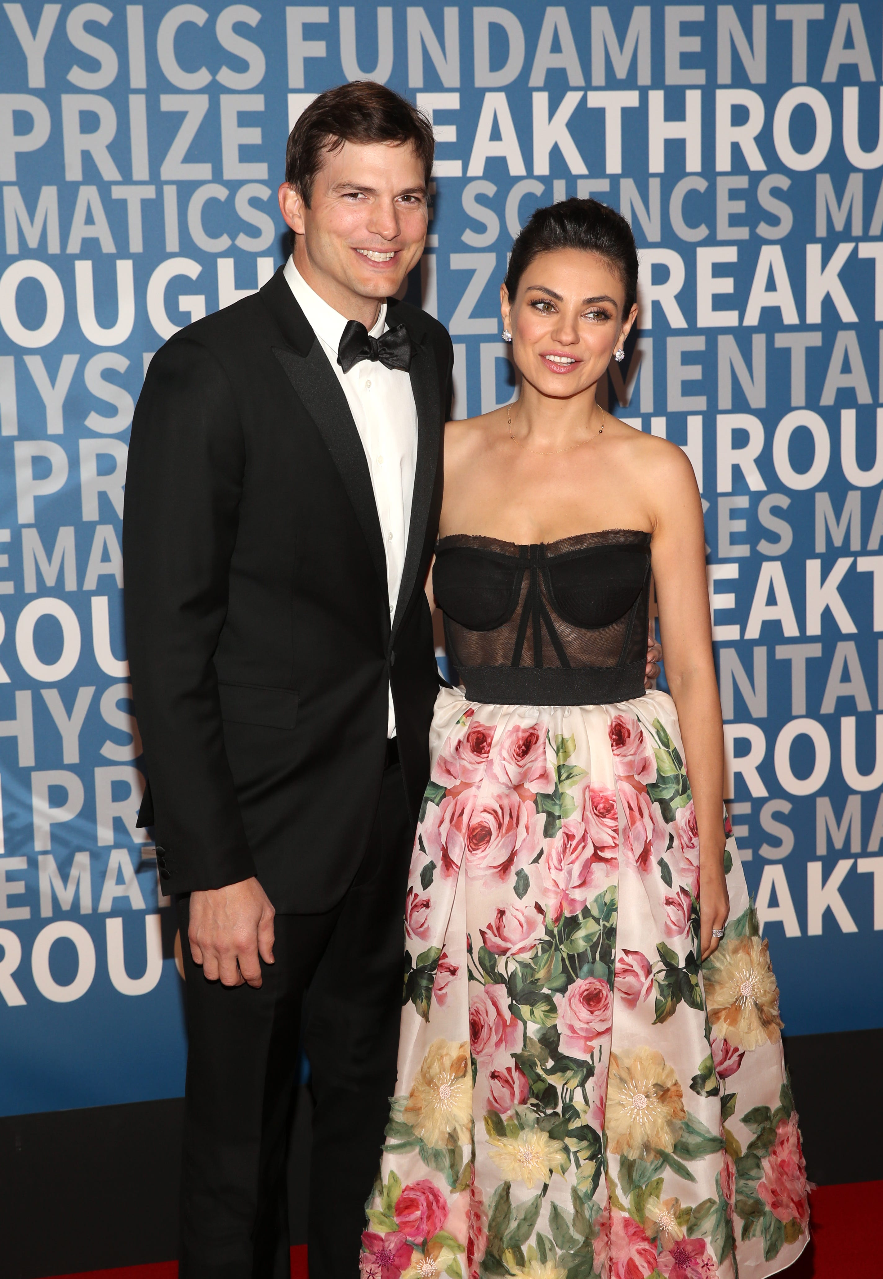 Kutcher and Kunis on the carpet.