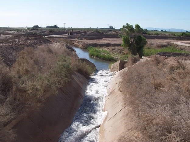 Colorado River water flows through the West Side Main Dixie spill toward the New River and the Salton Sea.