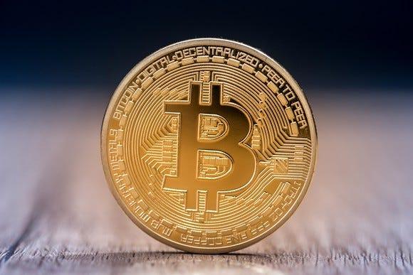 Bitcoin futures begin trading as price surges