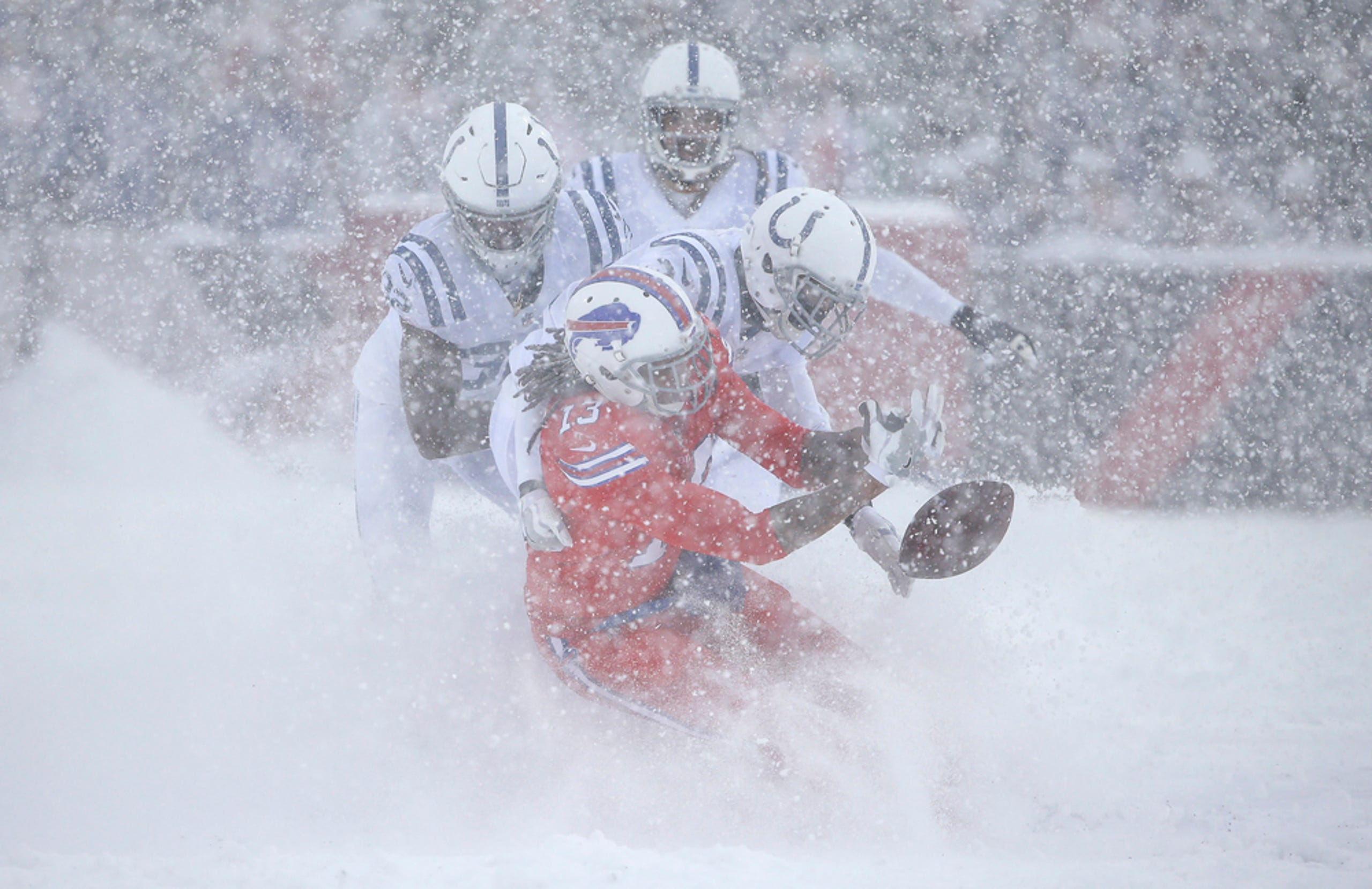 Snow Covered Colts Vs Bills Game Action Photos