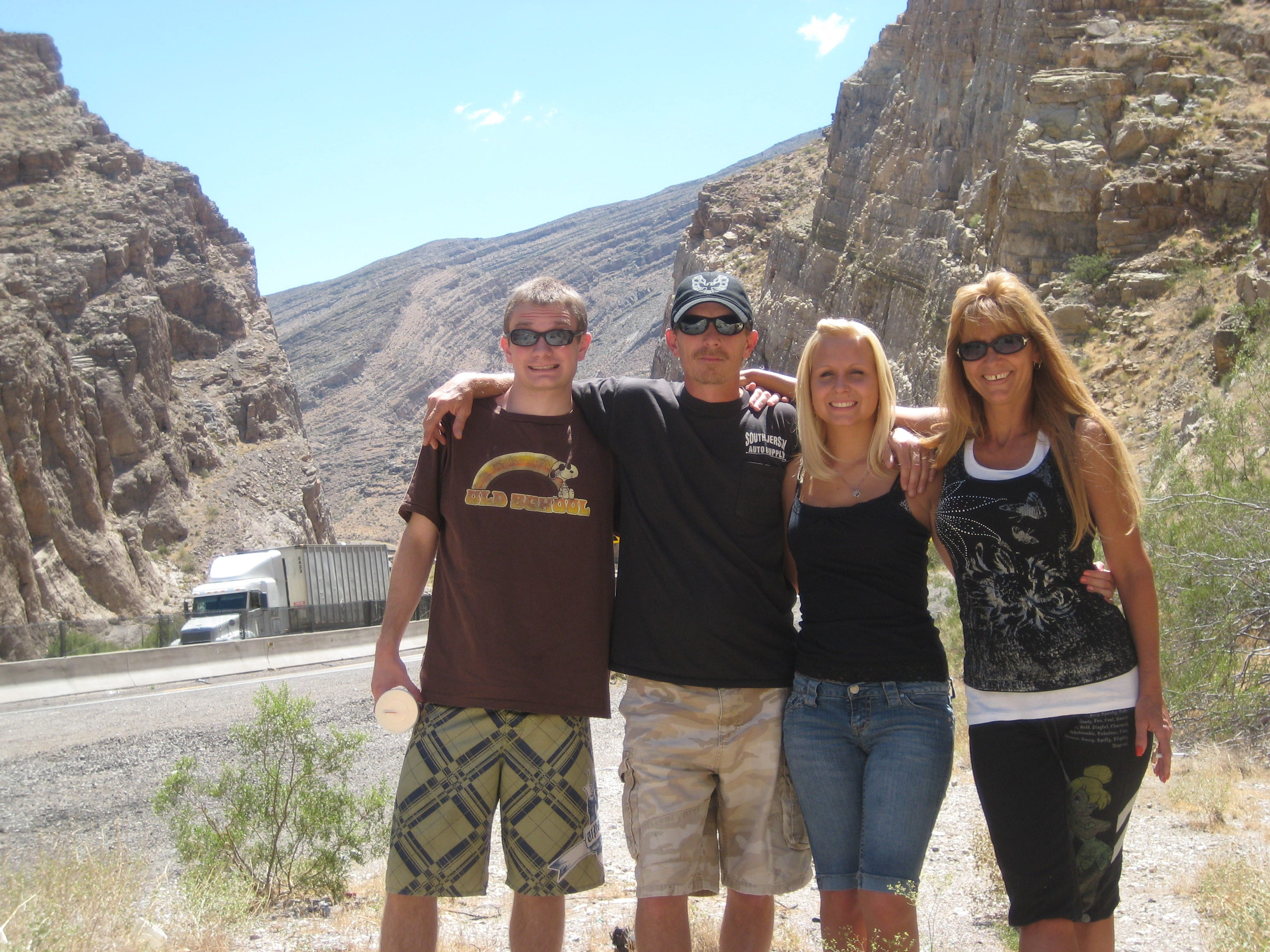Michael Riley (left) poses for a vacation family portrait with his father, Leonard Riley; his sister, Jessica, and his mother, Jennifer, at Zion National Park in southern Utah. Before he began experiencing violent episodes, Michael Riley was healthy and active, his parents said.