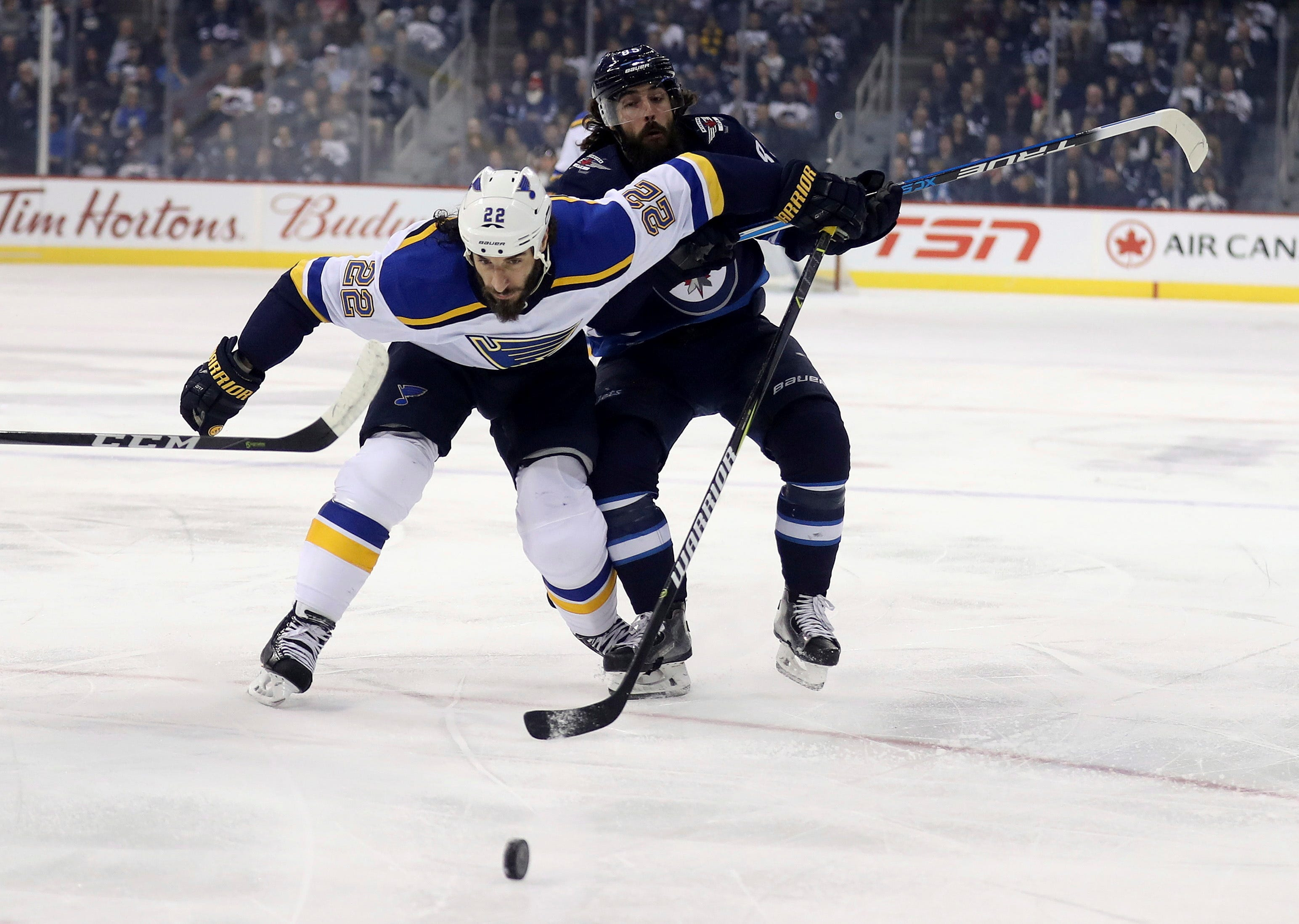 Hellebuyck stops 24 shots, Jets beat Blues 4-0