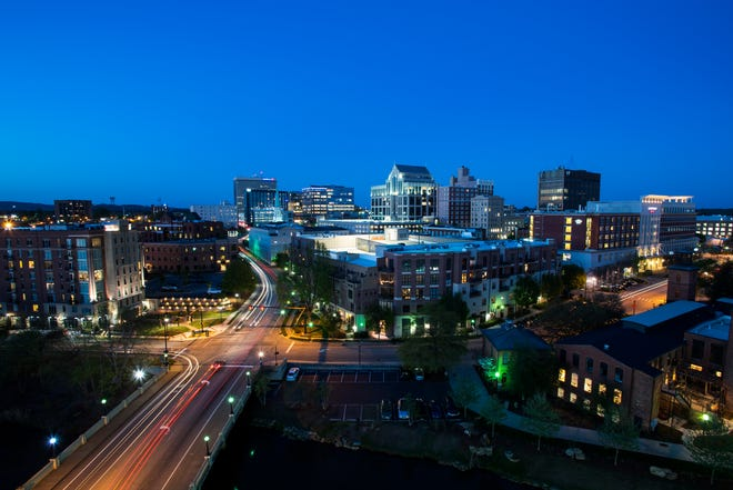 The downtown Greenville skyline is illuminated in this long exposure photograph on Tuesday, April 4, 2017.