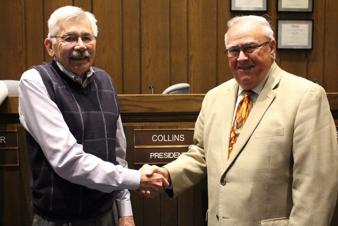 Jim Hellinger, left, is retiring as president of Ontario City Council.