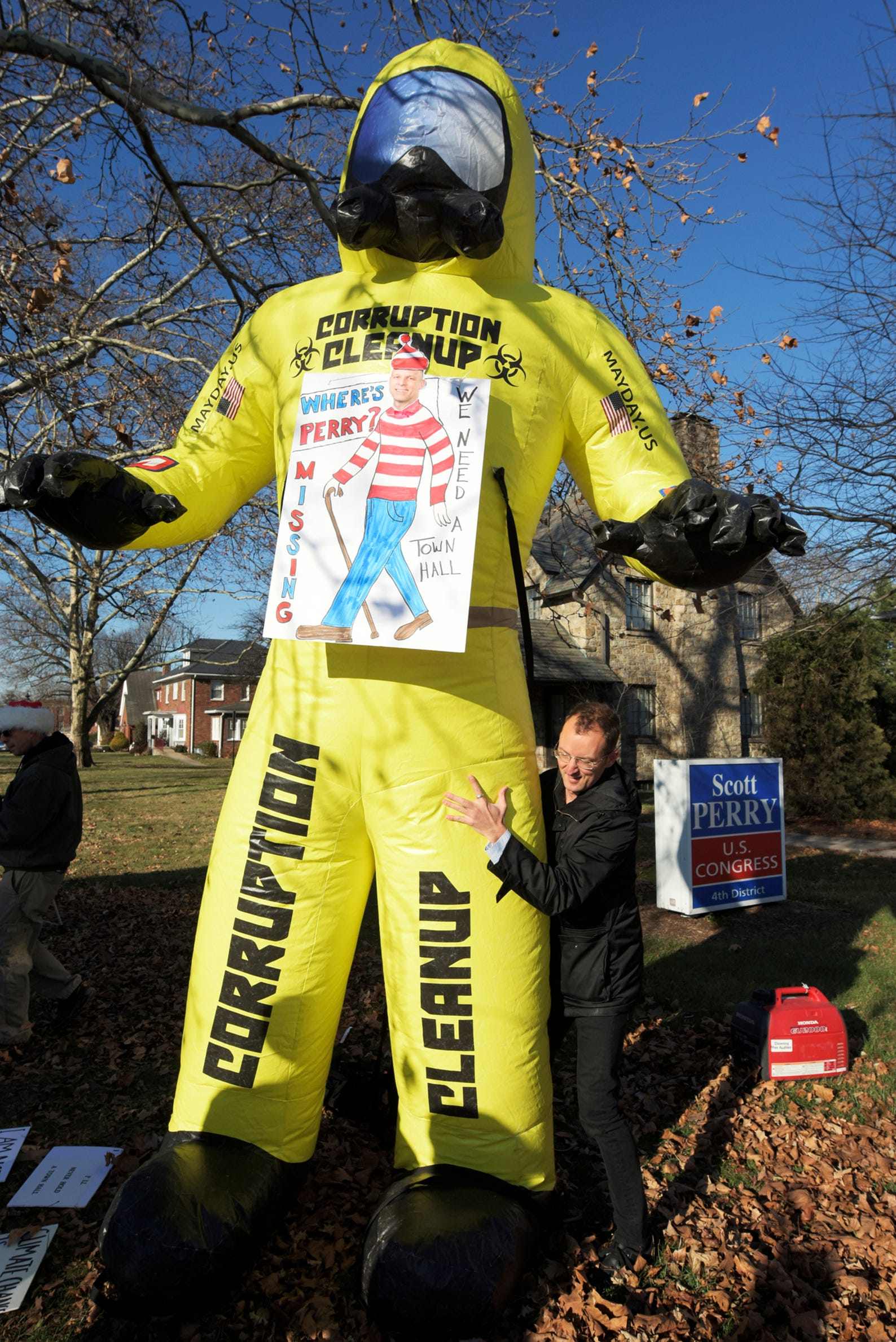 Mayday America member Chris Tallent of Baltimore positions and inflatable prop while preparing for a