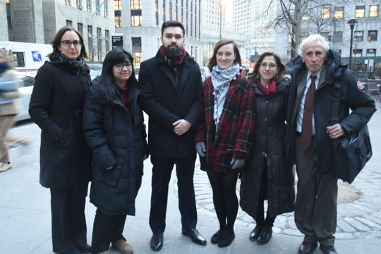 Ahmad Awad, center, with other Fordham students and supporters outside the courthouse in lower Manhattan in 2018.