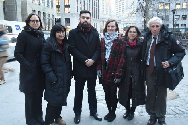 Ahmad Awad, center, with other Fordham students and supporters outside the courthouse in lower Manhattan on Wednesday. The students argued that Fordham ignored its own guidelines and practiced viewpoint discrimination when it denied them permission to start a Students for Justice in Palestineclubat the school.