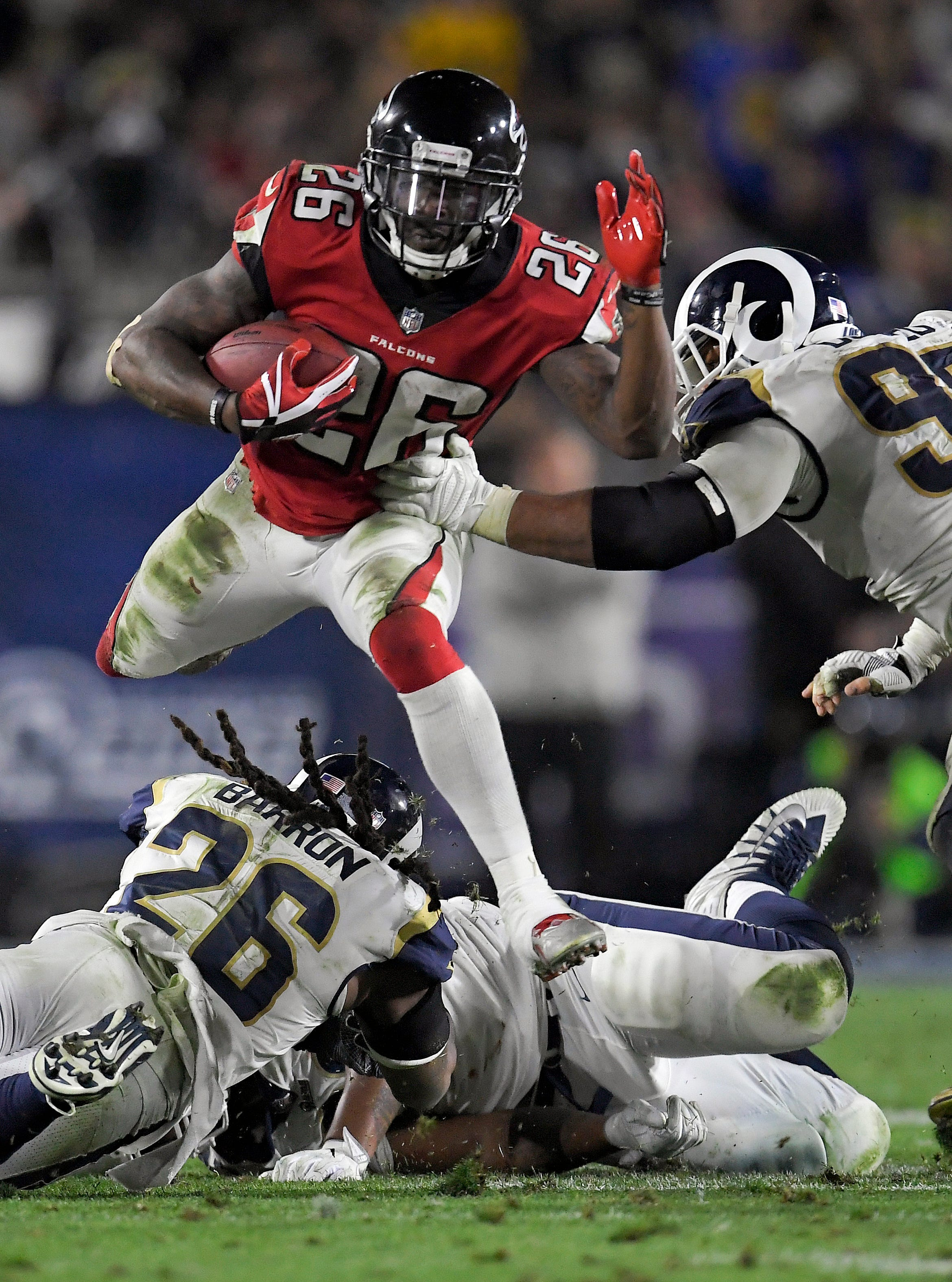 The Latest: Falcons topple Rams 26-13, face Eagles next
