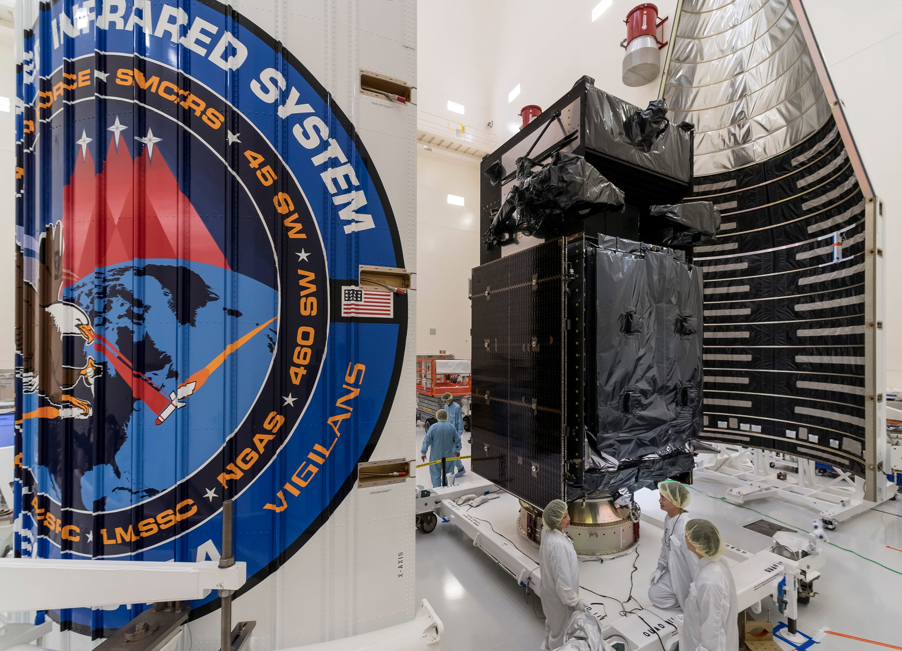 636511747888936219-sbirs-geo4-encaps-180110-F-ZZ999-102 Missile warning satellite moving to Atlas V rocket for launch next week