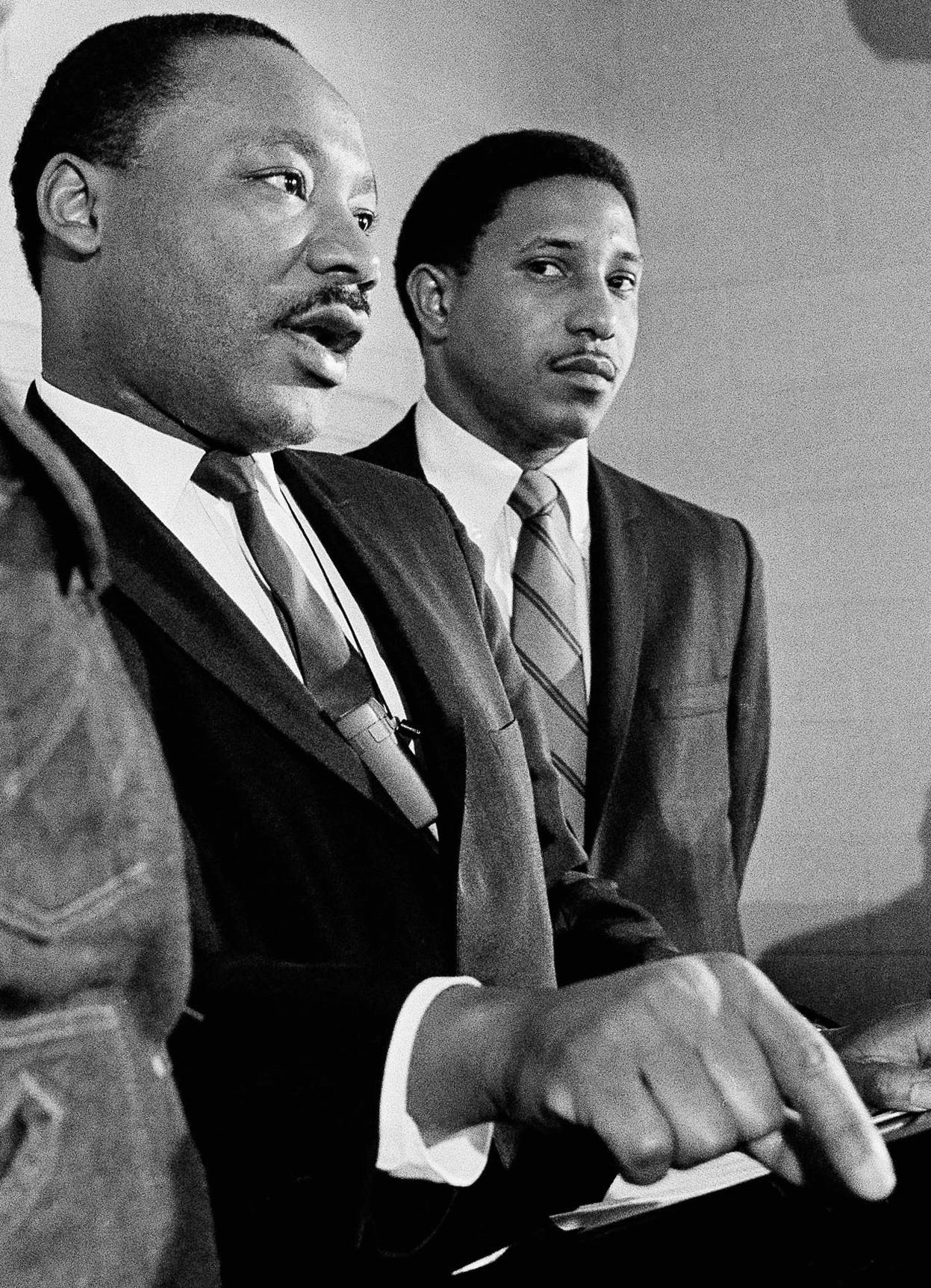 In this Tuesday, Jan. 16, 1968 file photo, Dr. Martin Luther King, accompanied by Rev. Bernard Lafayette, talks about a planned march on Washington, during a news conference in Atlanta.