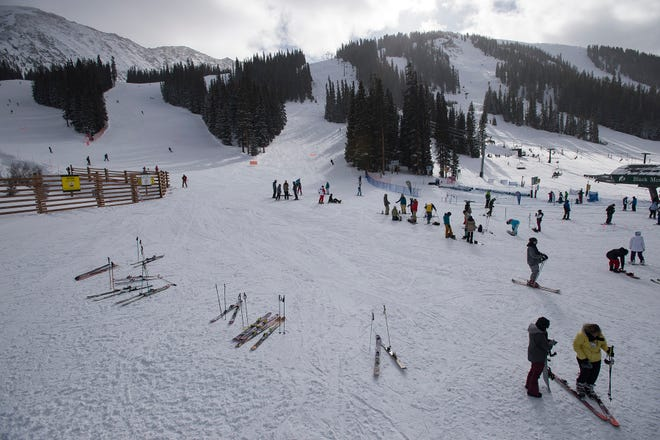 Patrons hang out at the bottom of the frontside of the mountain on Thursday, Jan. 11, 2018, at Arapahoe Basin Ski Area in Keystone, Colo.