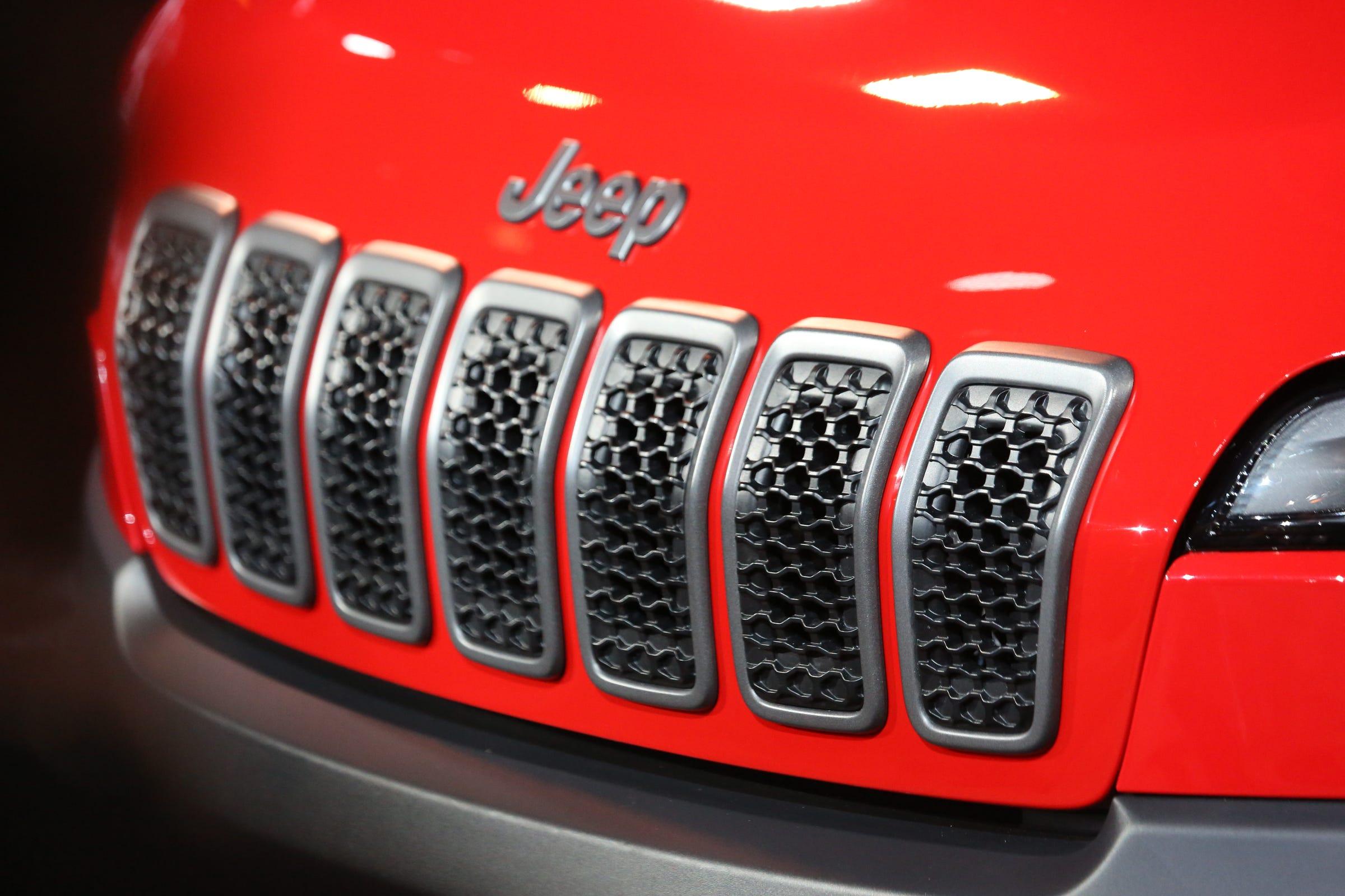 JeepCherokeejpg - Car sticker designripped torn metal design with evil eye monster motif external