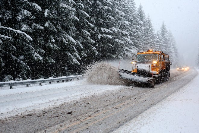 Snow plows run near Detroit Lake, Ore., on Monday, Dec. 5, 2016.