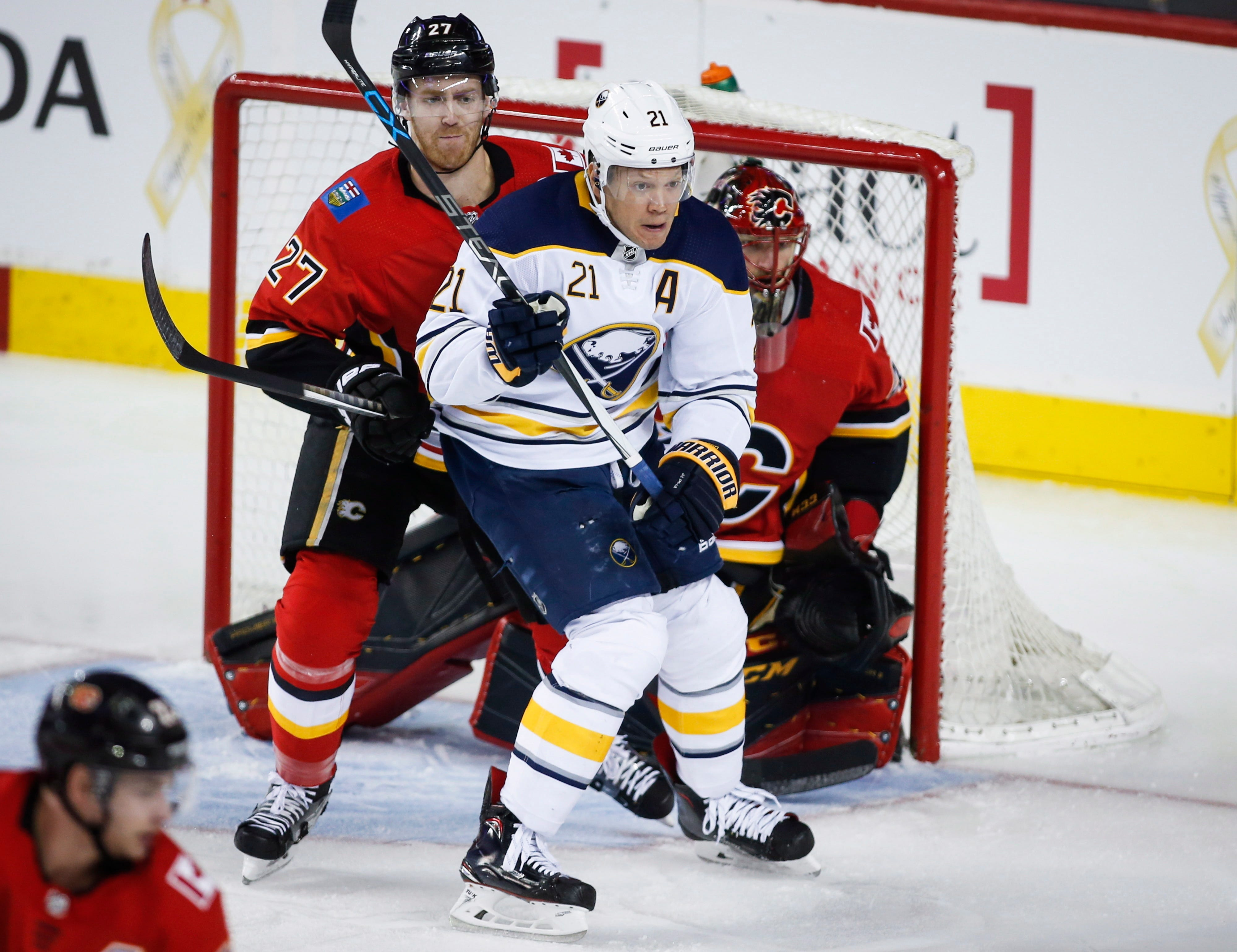 Eichel scores in OT to give Sabres rare win in Calgary
