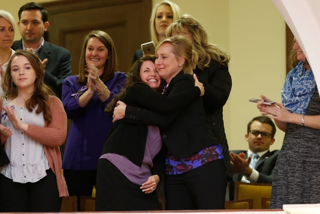 Marsy's Law State Director Ashley Christiansen hugs a supporter after passage of Senate Bill 3, known as Marsy's Law, in the House during the General Assembly at the Kentucky State Capitol in Frankfort, Ky., on Wednesday, January 24, 2018.