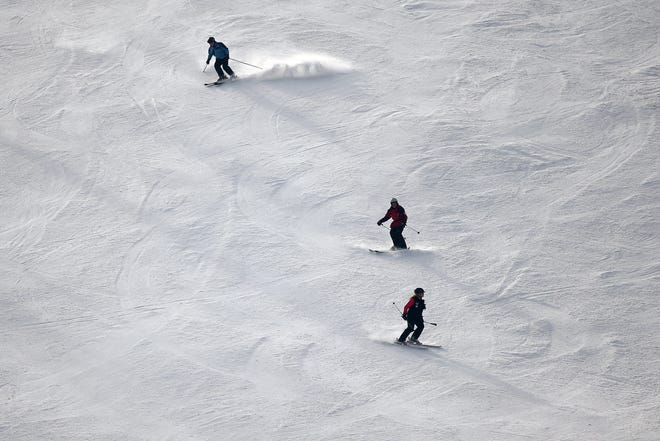 Experienced skiers negotiate a slope at Perfect North Slopes in Lawrenceburg, Indiana in 2018 in this Enquirer file photo.