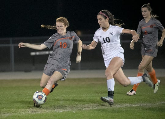 Lely's Saoirse Bowe tries to keep the ball from Mariner's Taylor Yount in the Region 3A-4 girls soccer quarterfinal game on Tuesday, Feb. 6, 2018, in Cape Coral.