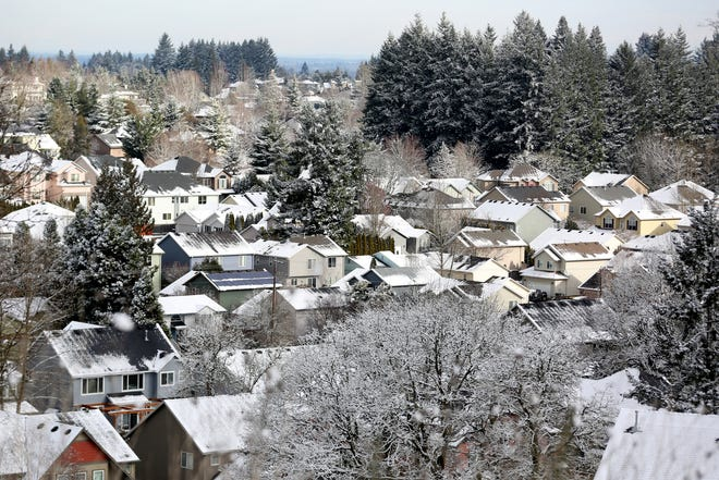 Snow blankets parts of south Salem on the morning of Thursday, Feb. 22, 2018.