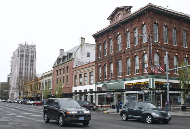 Traffic passes the Reed Opera House in downtown Salem.