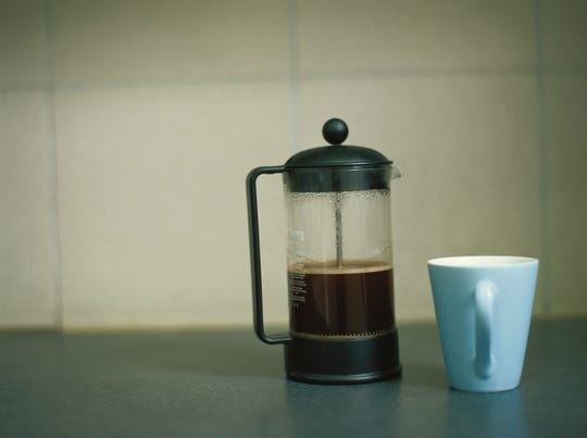 Cafetiere of French Press coffee and coffee cup.