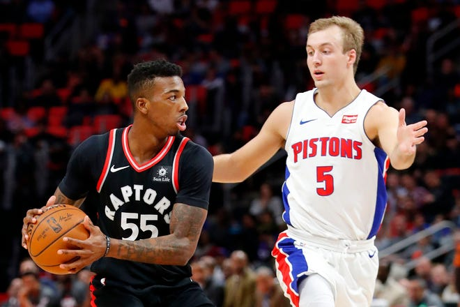 Toronto Raptors guard Delon Wright is defended by Detroit Pistons guard Luke Kennard in the first half at Little Caesars Arena on March 7, 2018.