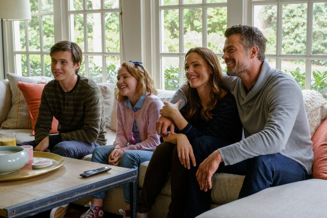 """Love, Simon"" charts the journey of a teen named Simon (Nick Robinson, left) as he comes out to his family (played by Talitha Bateman, Jennifer Garner and Josh Duhamel), his friends and his school."