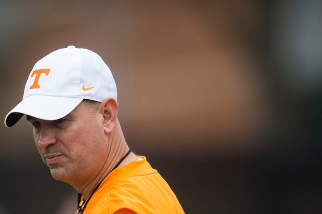 Tennessee head coach Jeremy Pruitt walks on the field during the first Vol football practice of the spring season at University of Tennessee in Knoxville, Tuesday, March 20, 2018.