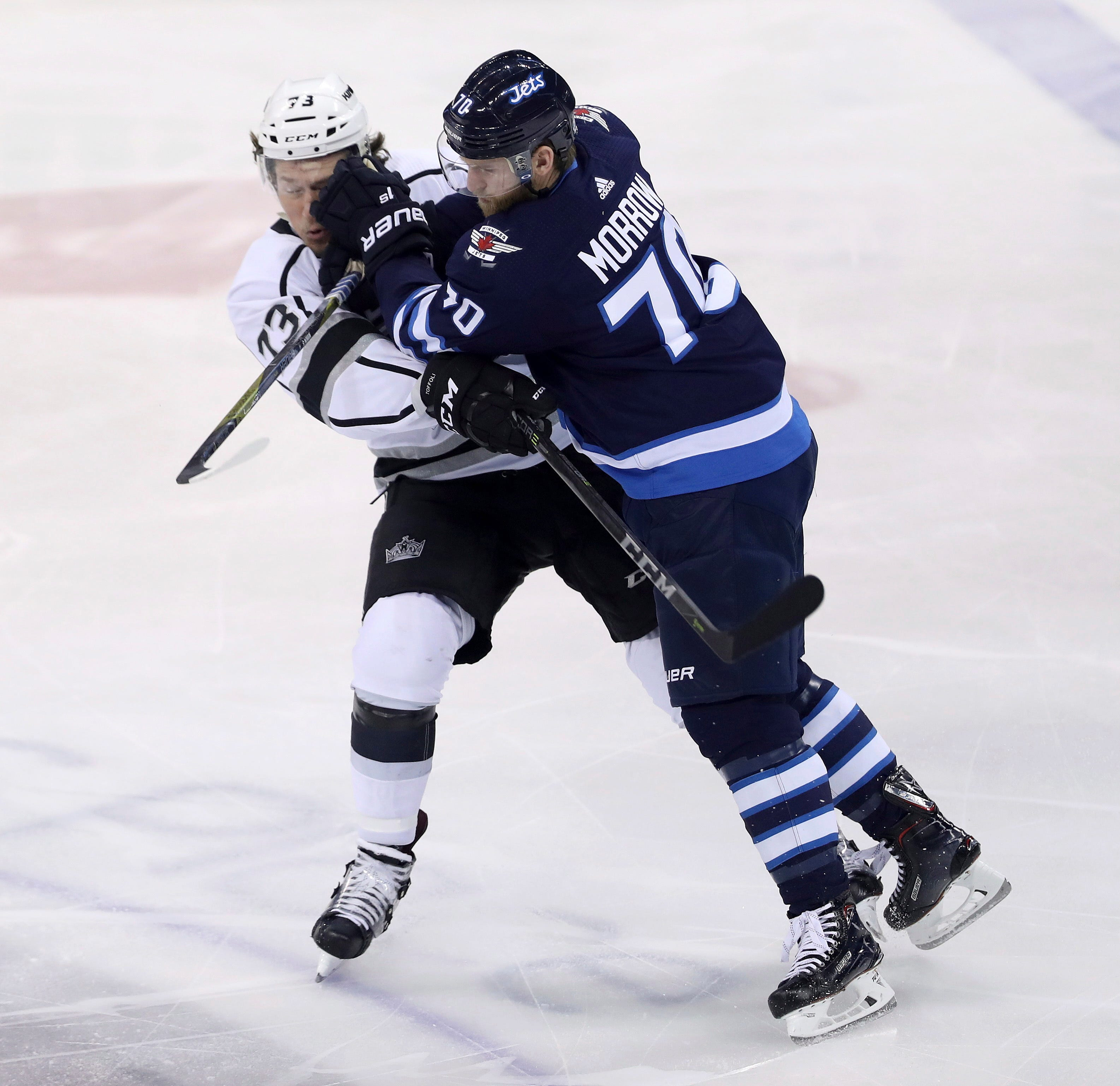 Connor lifts Jets in OT; Laine leaves with lower-body injury