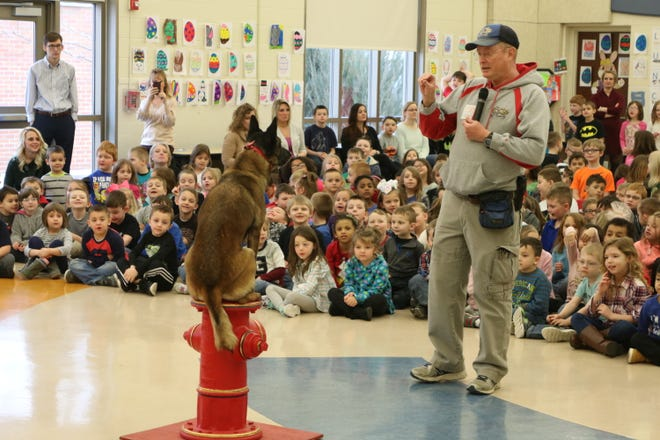 Mya, a 5-year-old Belgian Malinois from the Erie Shores K-9 Academy, performs with owner and trainer Marty Mortus during a visit to Bataan Primary School in 2017.