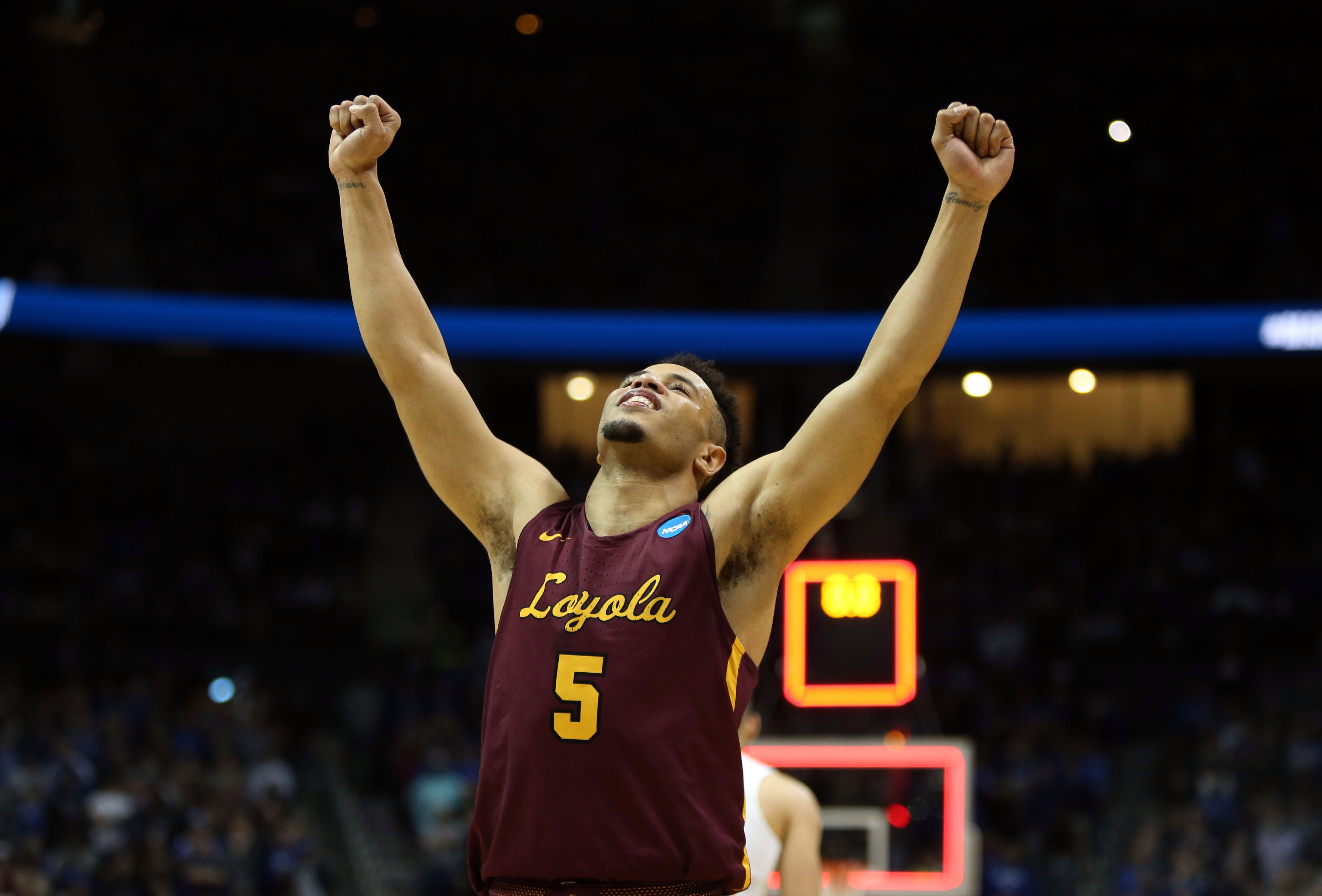 Loyola Ramblers guard Marques Townes celebrates after defeating the Nevada Wolf Pack in the semifinals of the South regional of the 2018 NCAA Tournament at Philips Arena in Atlanta.