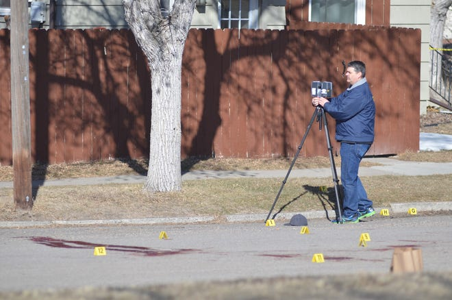 Great Falls Police Detective Keith Perkins sets up the FARO scanner to capture a 3-D image of the murder scene near 3rd Avenue and 16th Street South.