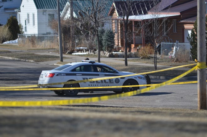 Great Falls police line the perimeter of the scene near Great Falls High School when James Michael Parker was accused of killing Lloyd Geaudry on March 23, 2018.