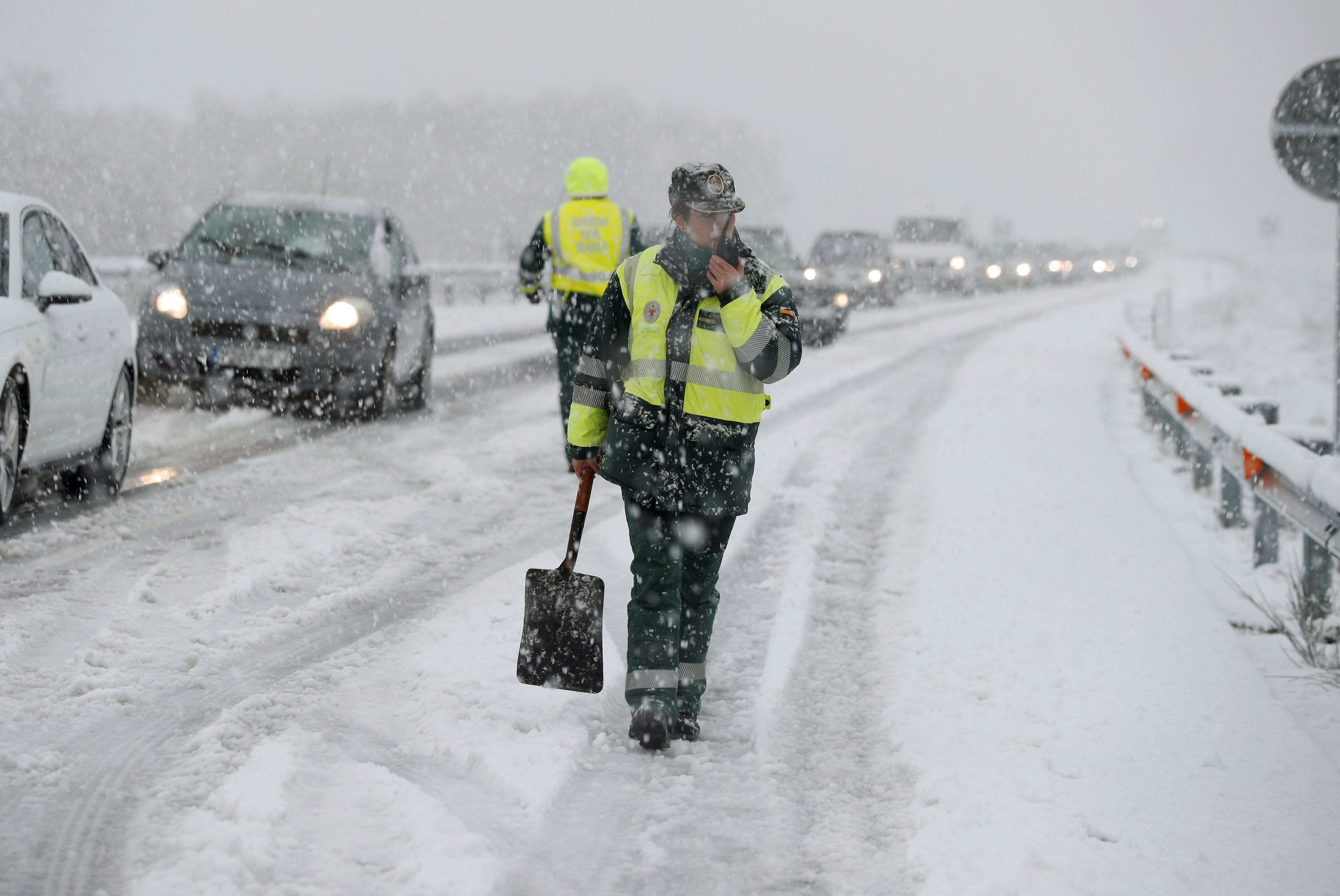 Civil guards control the traffic during snowfall in Lugo, Galicia, Spain.