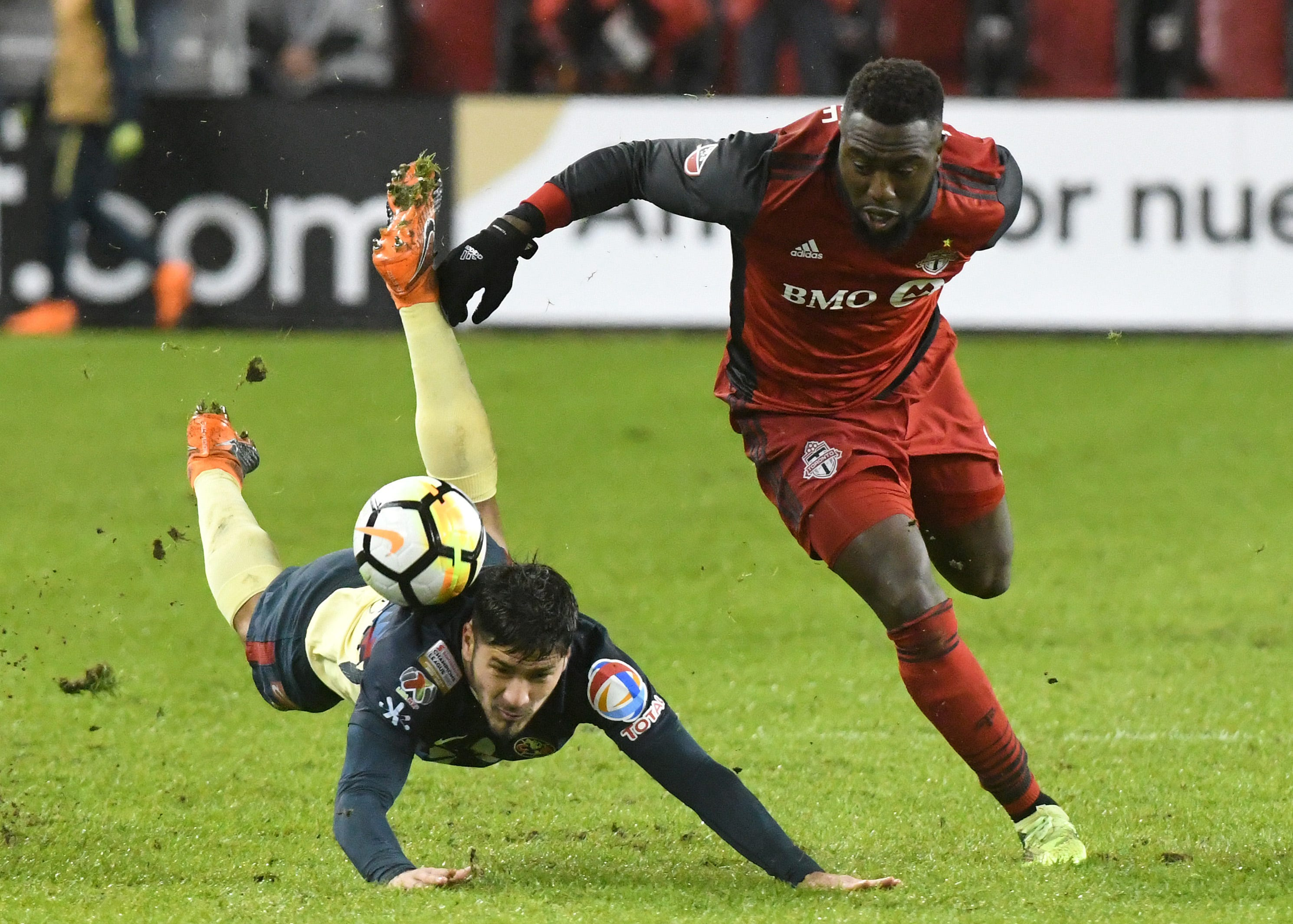 Toronto FC's Jozy Altidore battles for the ball with Club America defender Bruno Valdez (falling) during a CONCACAF Champions League semifinal at BMO Field. TFC won the game, 3-1.