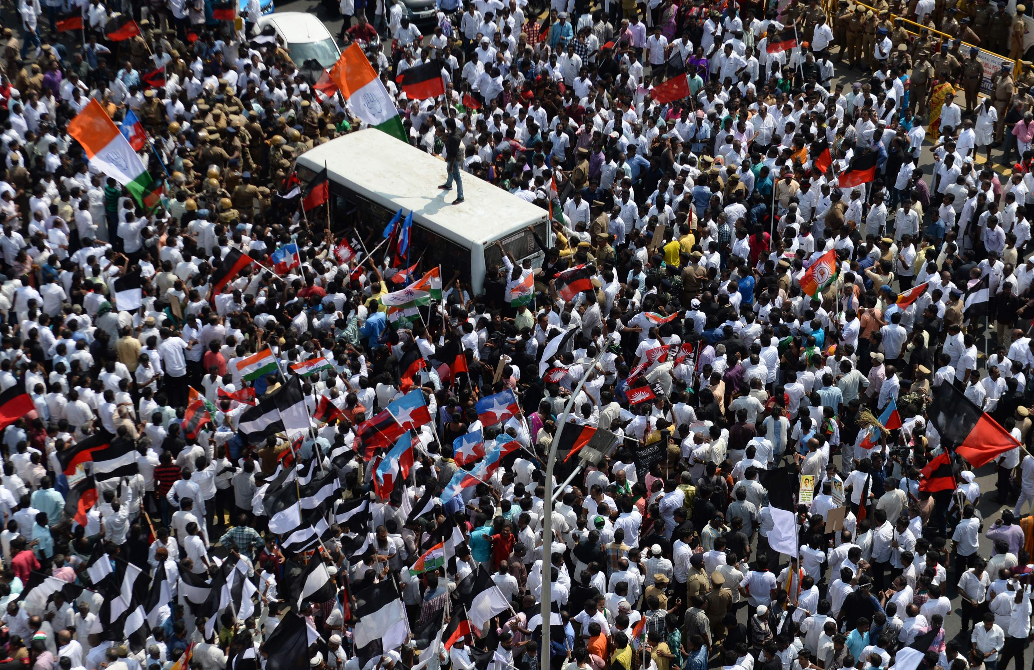 Indian members of the Darvida Munetra Kazhagam political party and opposition groups shout slogans during a protest against the union government against the union government over a delay in the implementation of a water management board in Chennai on