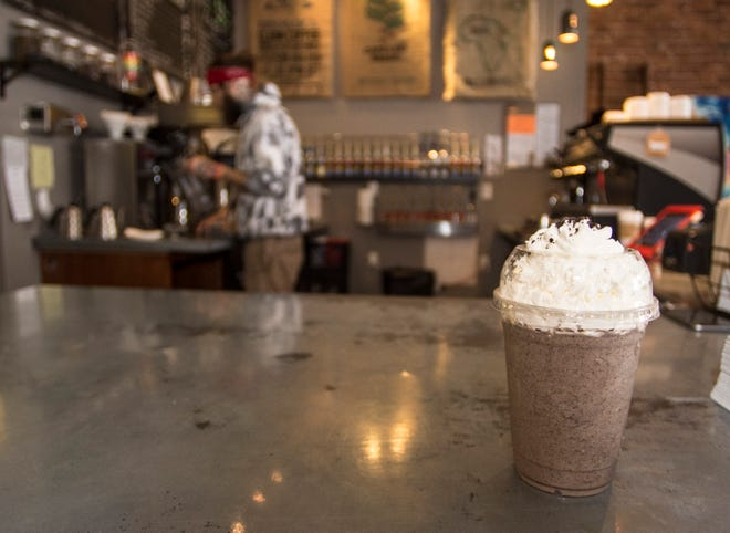 An Oreo Cookie Crumble frappuchino, without coffee, sits on the pick-up counter at Roscoe's Coffee Bar & Taproom in the Depot District on April 4, 2018.