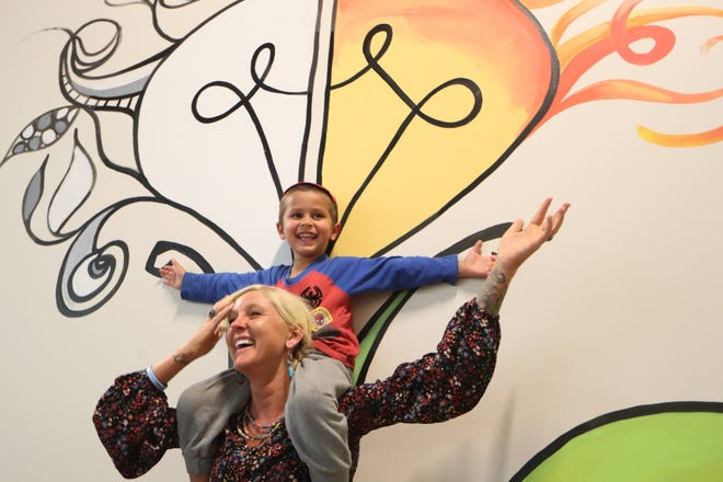 Carly Sinnadurai and her son Zade, 5, share a laugh at The Creative Play Lab, which she is opening as the new location of the Sharing Tree, with the addition of 7,000 square feet of play and learning space for children at the Centre of Tallahassee mall.