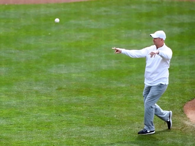 Jeremy Pruitt makes the first pitch in the Tennessee and Florida game at Lindsey Nelson Stadium on Sunday, April 8, 2018.