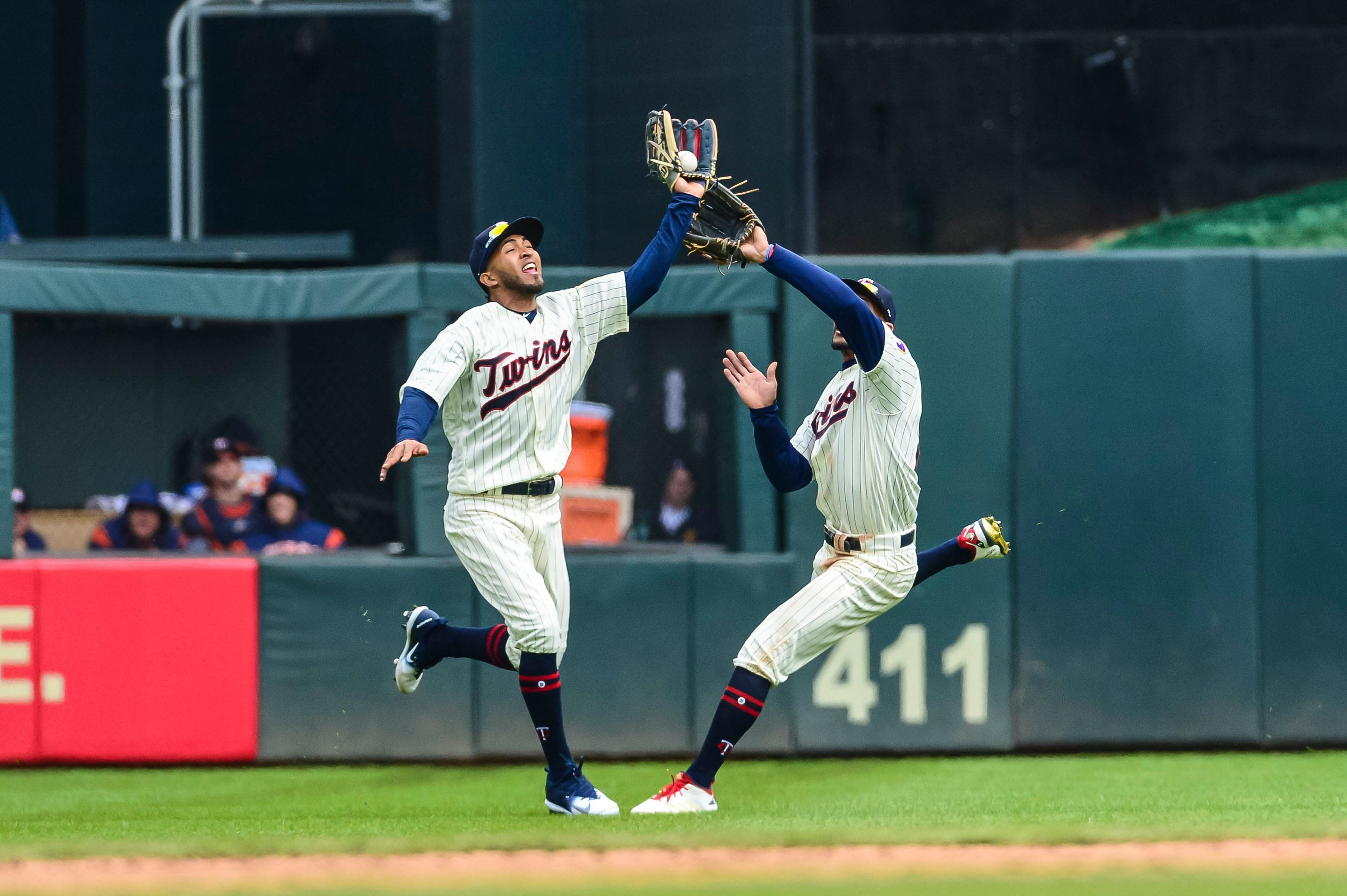 Minnesota Twins left fielder Eddie Rosario, left, runs in front of center fielder Byron Buxton to catch a fly ball off the bat of Houston Astros third baseman J.D. Davis during the fifth inning at Target Field in Minneapolis.