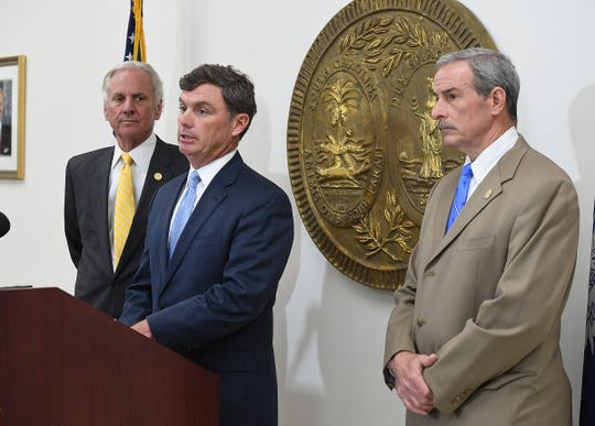 This file photo from 2018 shows State Law Enforcement Division Chief Mark Keel on the far right.
