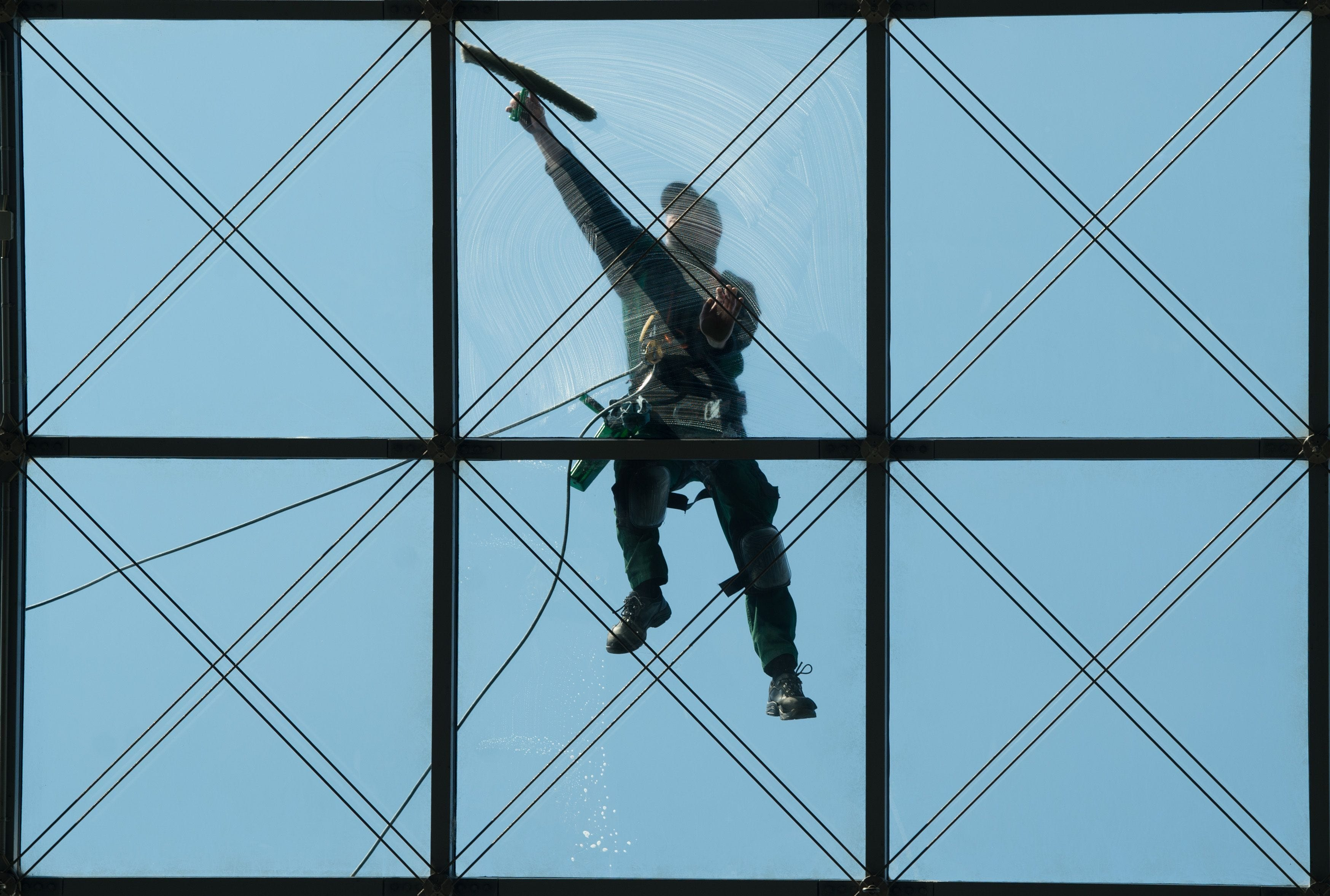 A building cleans the glass roof of World Trade Center in Dresden, Germany.