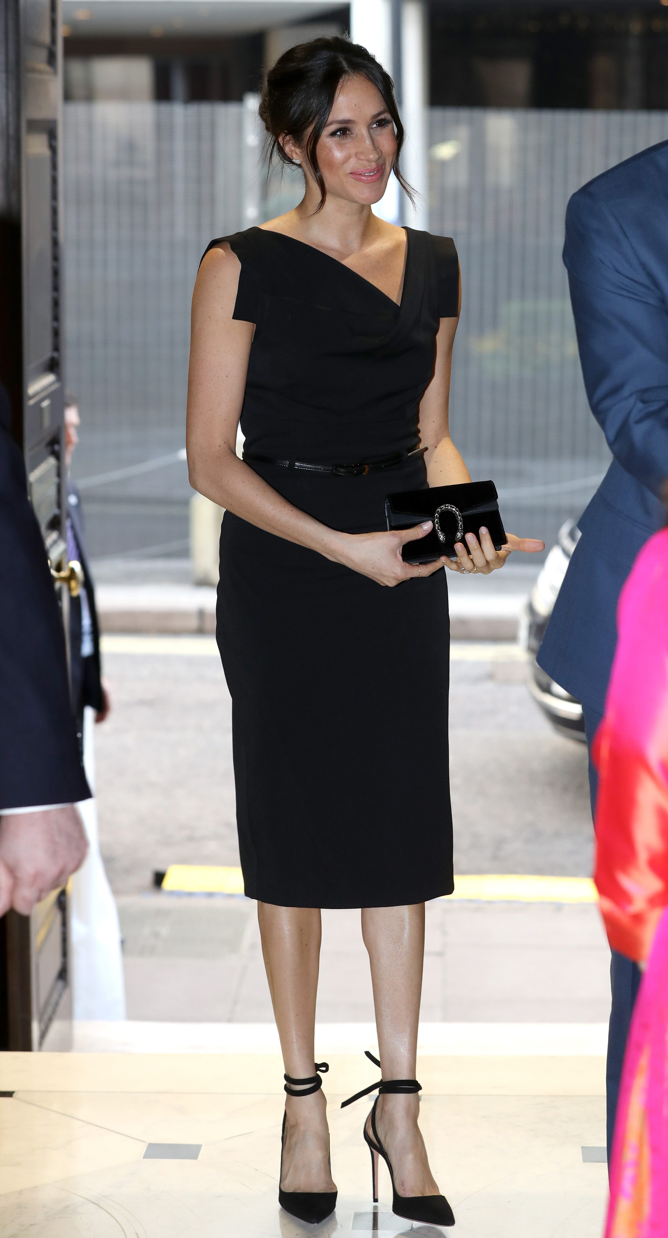 Meghan Markle looks sleek (and breaks royal protocol) in all black with a Gucci clutch