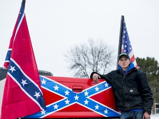 Michigan high school closes after Confederate flag-bearing trucks park outside for two days