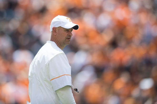 Coach Jeremy Pruitt walks on the field during the Tennessee Orange & White spring game at Neyland Stadium on April 21, 2018.