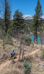 A mountain bike rider navigates a trail at Grindstone Lake in Ruidoso.