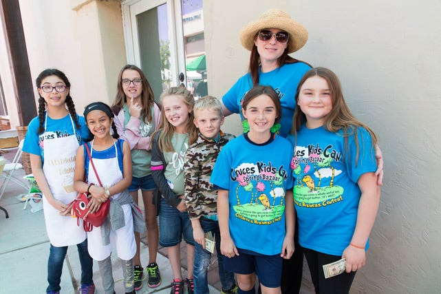 The winners of the Cruces Kids Can Spring Bazaar Business Competition stand with organizer April Christensen following the event in the file photo from Saturday, April 21, 2018. Christensen has been named Nusenda Credit Union and the Nusenda Foundation's most recent Financial Education Innovator.